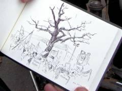 Der Maler Matthias Koeppel mit einer Skizze auf der Demo zum Erhalt von Grünflächen und für eine soziale und lebenswerte Stadt (14. November 2014)